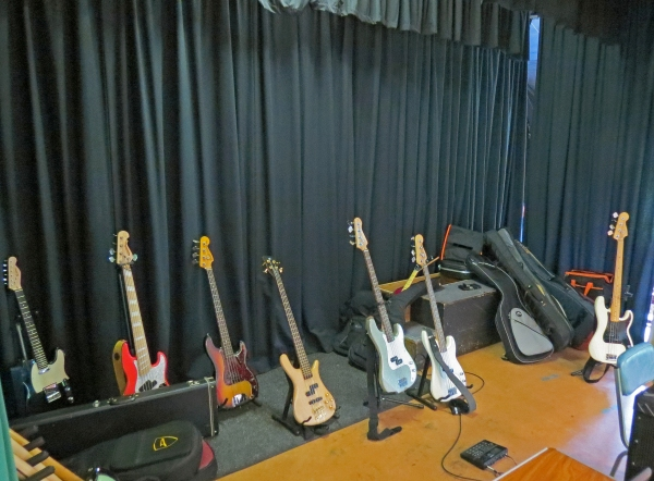 some-of-the-basses-in-the-test-and-a-guitar